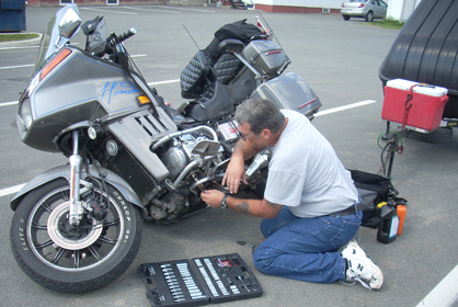 Ernie Dube Changes a starter on his goldwing in the parking lot - www.Motorcycles123.com