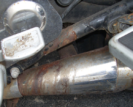 Acid damage to an exhaust pipe - www.MotorCycles123.com